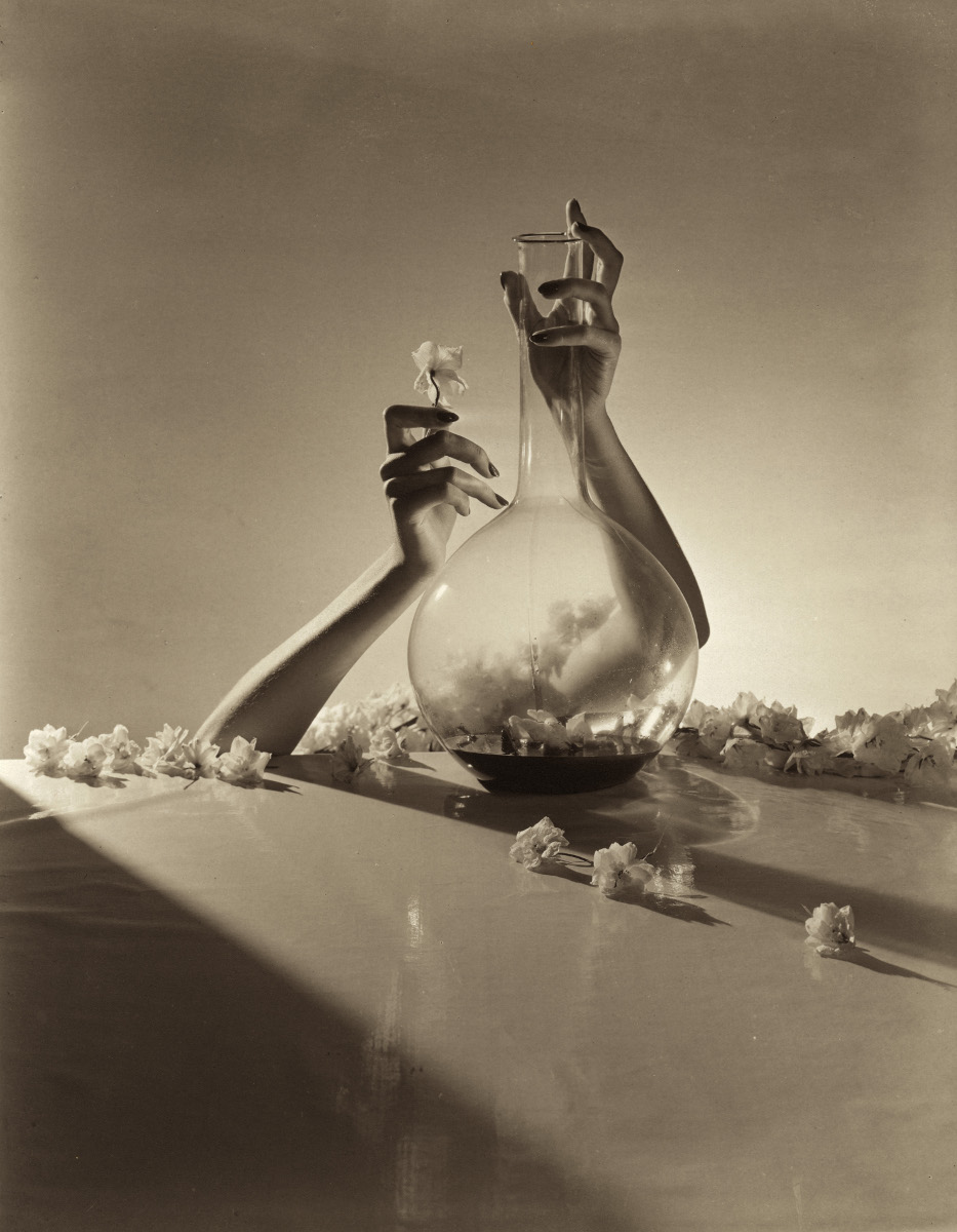 Hands with flowers and fiask - Horst P. Horst